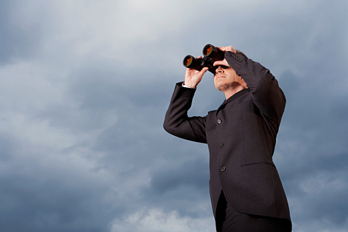 Businessman Looking Through Binoculars