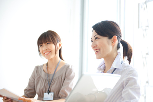 Japanese Businesswomen at business meeting, smiling