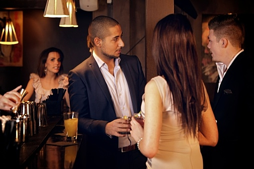 Young Businessman Hanging Out with Friends at the Bar